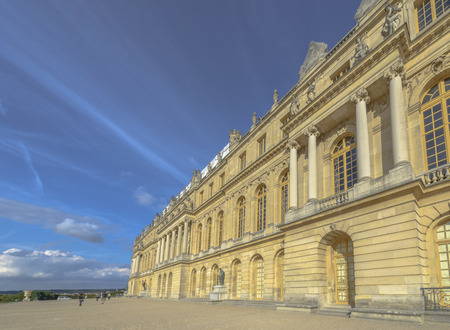 louis the rich heritage: Versailles Chateau exterior in a sunny day near Paris, France