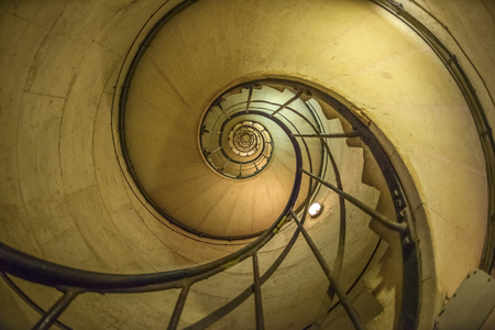 Spiral Staircase in Arc de Triomphe in Paris, France photo