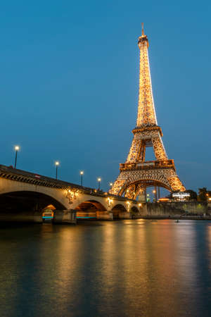 Paris - August 28: Long night Exposure of Eiffel Tower and Seine River at dusk from Port Debilly in Trocadero on August 28, 2013 in Paris, France