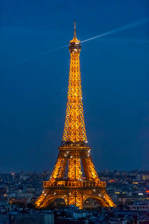 Paris - September 1: Eiffel Tower at dusk as seen from the Arc de Triomphe on September 1, 2013 in Paris, France