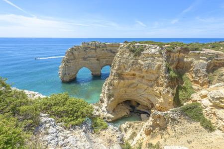 Sea Arch in Praia da Marinha in Algarve, Portugal photo