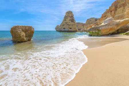 General view of the world famous Marinha Beach with the blue water and rock outcroppings  in Portugal. 版權商用圖片