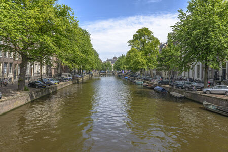 amstel river: One of Amsterdam Canals in a summer day Editorial