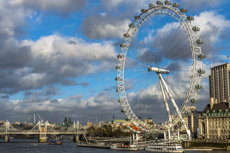 millennium wheel: London Eye with semi-cloudy sky in City of Westminster, London.