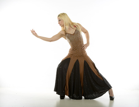 Young model dressed up as a dancer against a White Background.