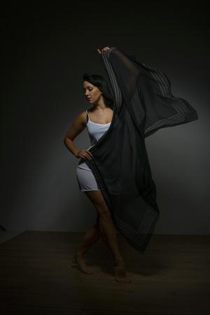 Young model Dancing in Studio wearing a Lingerie Stockfoto