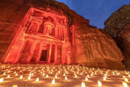 Treasury (Khasneh) in Petra, Jordan at night. Petra by Night in the light of 1,800 candles.