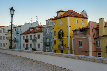 Typical exterior of old houses in a narrow street in Lisbon, Portugal