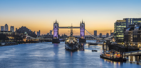 Panorama view of Tower Bridge and HMS Belfast  at sunrise in London, England