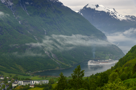 End of the famous Geiranger fjord, Norway with cruise ship- view from cottage Stockfoto
