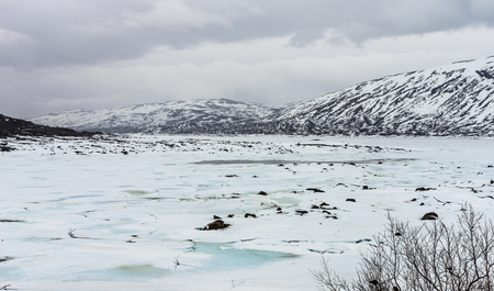Frozen mountain lake with ice and snow-lake Stavatn in Telemark, Norway.