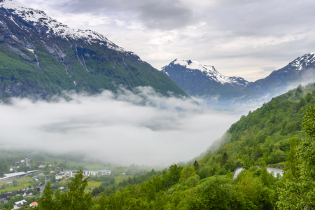 Foggy Geiranger fjord Norway- view from the end Stockfoto