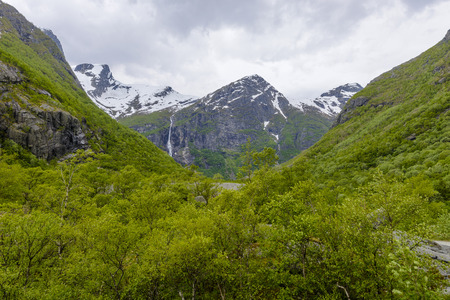 Green Mountains with Glacier Briksdal, a view from the back Stockfoto - 103788053