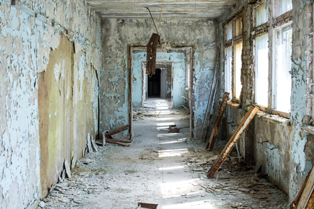 Corridor of abandoned middle school in Pripyat city in Chernobyl Exclusion Zone, Ukraine