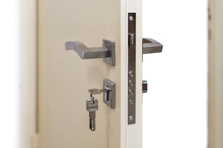Open door. Door lock, metal door. Modern interior design, door handle. New house concept. Real estate. Imagens