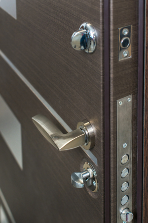 Open door. Door lock, Dark brown door closeup. Modern interior design, door handle. New house concept. Real estate.