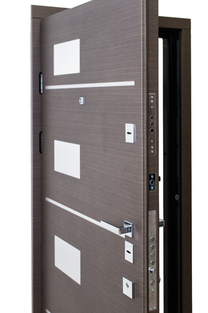 Open armored door isolated at white background. Image of a open door. Entrance to apartment. Brown wood veneer front door for office, with lock and handle. Modern Door design.