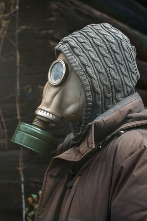 Portrait of a man in a gas mask. Panic during quarantine. Coronavirus pandemia concept. Stalker in a gas mask, Chernobyl Exclusion Zone Imagens