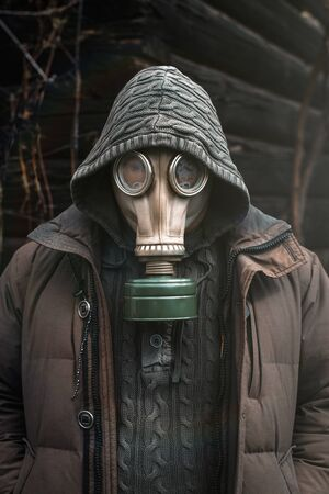 Portrait of a man in a gas mask. Panic during quarantine. Coronavirus pandemia concept. Stalker in a gas mask, Chernobyl Exclusion Zone Imagens - 147852955