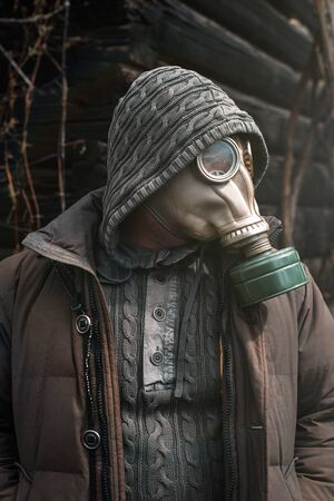 Portrait of a man in a gas mask. Panic during quarantine. Coronavirus pandemia concept. Stalker in a gas mask, Chernobyl Exclusion Zone Imagens - 147852956