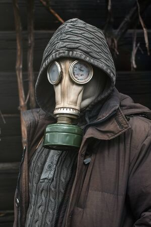 Portrait of a man in a gas mask. Panic during quarantine. Coronavirus pandemia concept. Stalker in a gas mask, Chernobyl Exclusion Zone Imagens - 147852958