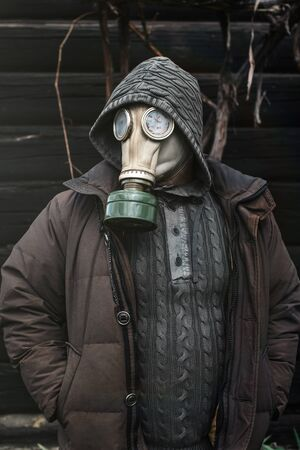 Portrait of a man in a gas mask. Panic during quarantine. Coronavirus pandemia concept. Stalker in a gas mask, Chernobyl Exclusion Zone Imagens - 147853032