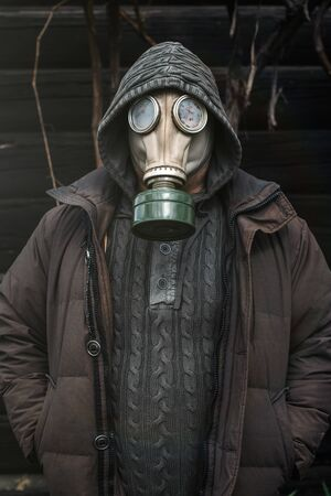 Portrait of a man in a gas mask. Panic during quarantine. Coronavirus pandemia concept. Stalker in a gas mask, Chernobyl Exclusion Zone Imagens - 147853034