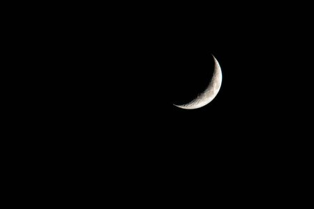 young moon on black background - Waxing Crescent Imagens - 147853422