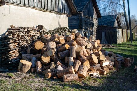 Firewood for furnace heating. Warehouse firewood for stove. Firewood stacked and prepared for winter Pile of wood logs Imagens
