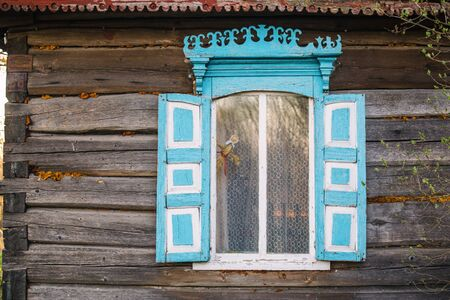 Old window of wooden house in Chernobyl exclusion zone. Imagens