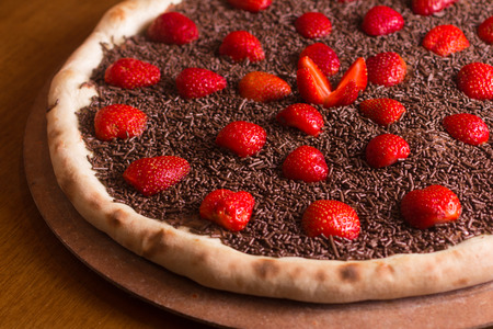 Chocolate Pizza Dessert with strawberry and sprinkles