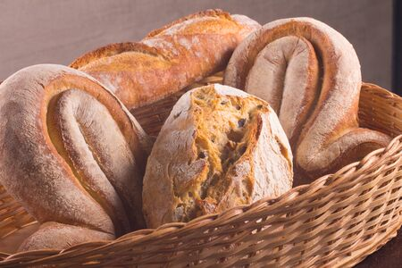 French Bread Basket with baguete, champagne and rustic bread