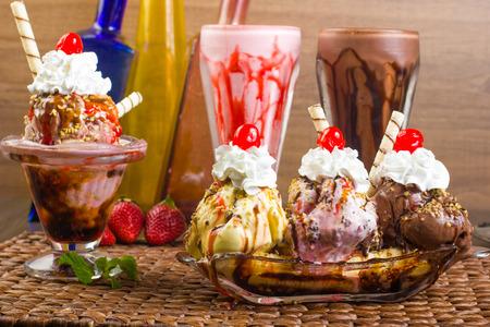 Party food. Milkshake, sundae and banana split Archivio Fotografico