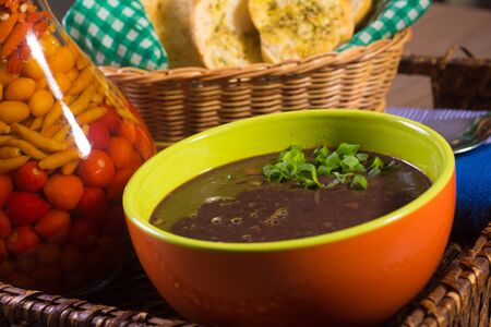 beans soup: Brazilian Beans Soup with toats breads and chives