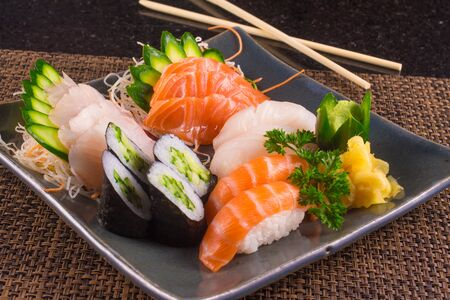Traditional Japonese Food with sushi, sashimi and rolls Archivio Fotografico