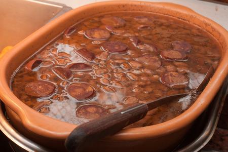 Traditional Brazilian Feijoada with cabalbresa and paio Imagens