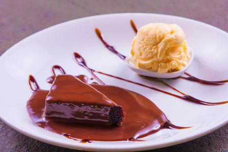 gateau: Petit Gateau Dessert with chocolate syrup and ice cream