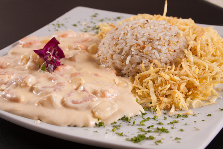 Stroganoff Shrimp with rice and french fries