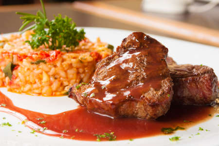 wine sauce: Fillet Mignon with wine sauce and Risotto Stock Photo