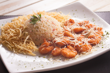 breaded: Breaded Shirimp with rice, chips and grana padano