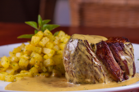 saute: Fillet Mignon with mustard sauce with saute potato