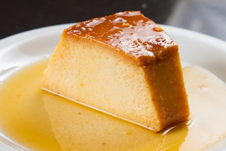 Traditional Brazilian Milk Pudding Dessert with sugar sauce