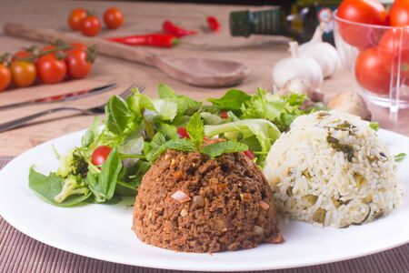 soja: Soy meat, rice and Fresh and healthy Salad over a wooden table