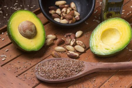 Sources of healthy fats, avocado, nuts and linseeds