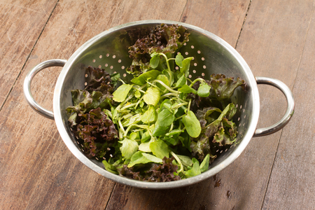 water cress: Fresh Waterclass Salad over a wooden table