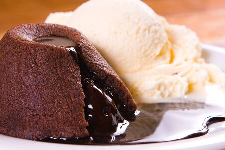 Patit Gateau with Ice Cream over a wooden table