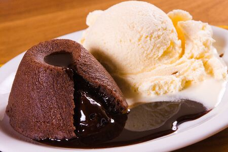 gateau: Patit Gateau with Ice Cream over a wooden table