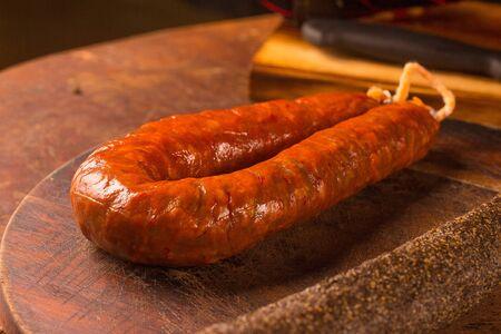 chorizo: Traditional chorizo sausage over a wooden table