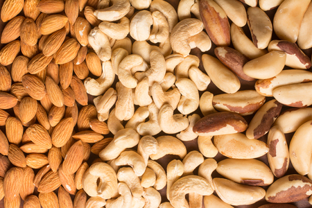 unsaturated: Almonds, Cashew and Para Nuts over a wooden table