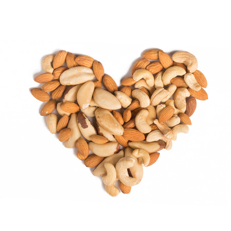 para: Almond, cashew and Para nuts heart shaped in white background
